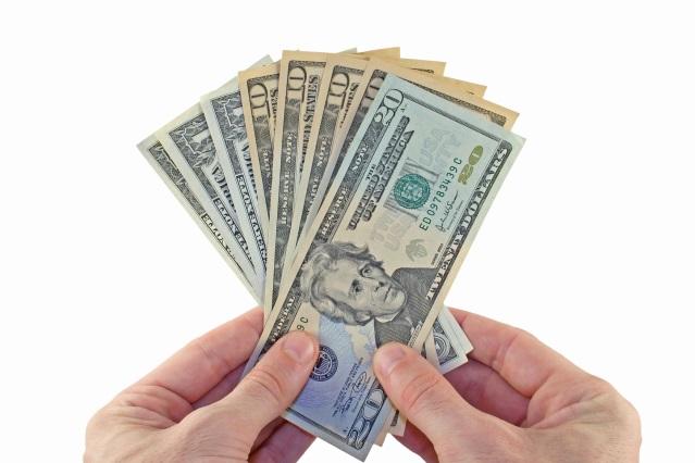 hands fanning out paper money