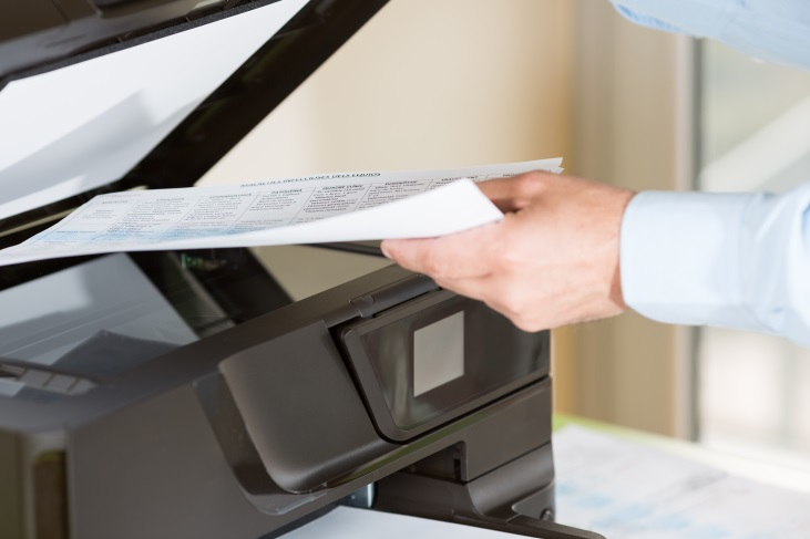 man making copies on a lexmark printer